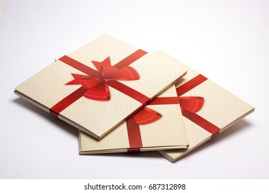 old paper packing with red ribbon and red bow on a white background/old paper bag/holiday gifts, design and layout