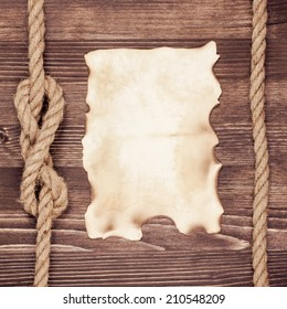 Old paper poster blank on vintage wooden wall background with rope