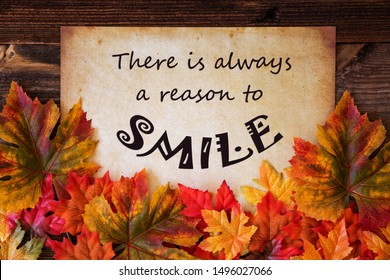 Old Paper With Quote Always A Reason To Smile, Colorful Leaves Decoration