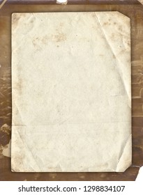 Old paper texture with stains and scratches on the vintage photo background