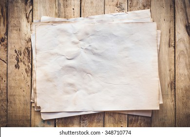 Old paper vintage on wood background with space