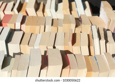 old Paperbacks in a bookshelf of a bookstore