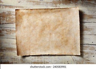 old parchment on aged white wooden wall, horizontal