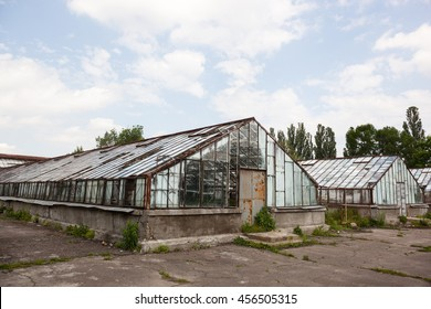 Old and partly damaged greenhouse for growing plants.
