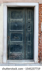 Old, partly damaged and rustic door