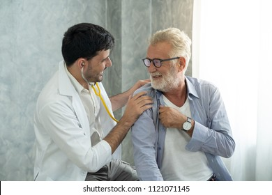 An old patient is consulting to a young doctor about his backache symptom