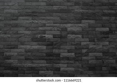 Old pattern stone wall background. Black brick wall abstract. rough solid texture and grunge surface backdrop for architecture material decoration or retro interior room concepts.