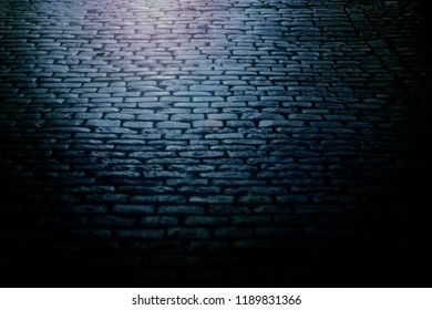 Old paving stones at night.Toned