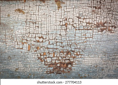 Old and peeled creaky paint , In course of time the paint of  white   tone peeled off the old planks  and crackled, wood texture, background, colorful, cracks in the paint, vintage, abstract, grunge,