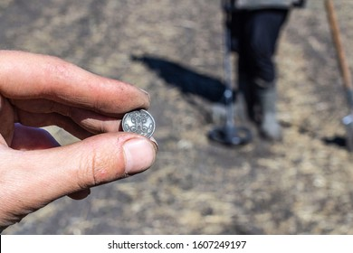 an old penny of Tsar Nicholas the second Emperor of Russia, found during excavations using a metal detector on an abandoned fortress, the front and background blurred with the effect of bokeh