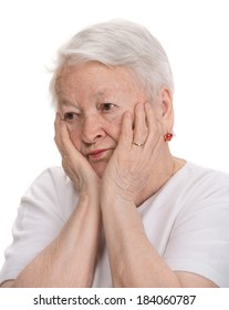 Old pensive woman on a white background
