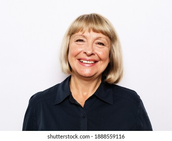 Old people and modern lifestyle concept. Portrait of senior woman with cute smile over white background