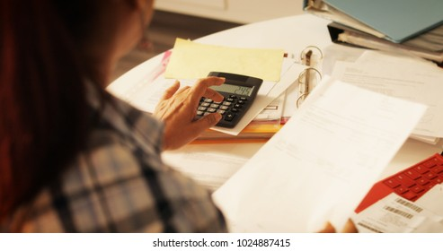 Old people, tax return and home banking. Senior woman paying federal taxes, doing family budget. Elderly person typing on calculator. Concept of money, finance, financial problems
