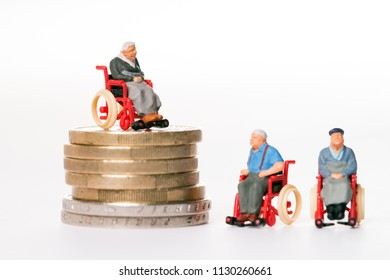old people in wheelchairs and coins