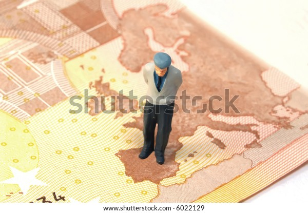 old person figure over a banknote