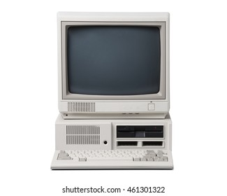 Old personal computer isolated on white background.
