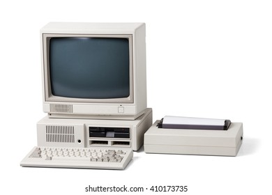 Old personal computer. The system unit, floppy drive, monitor, printer and keyboard isolated on white background.