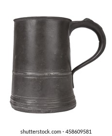 An old pewter drinks tankard isolated on a white background