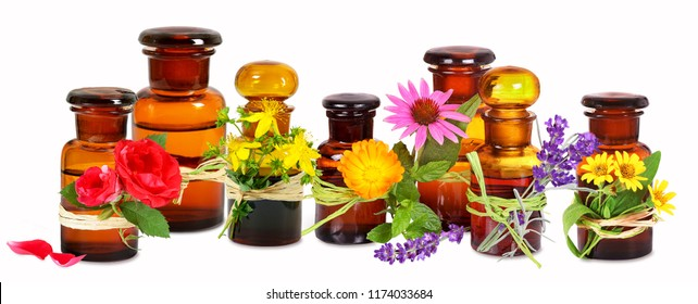 Old pharmacist glass bottles with medical plants