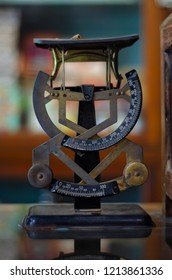Old pharmacy scale weight. old pharmacy interior with a lot of medicine and old equipment.Herb and drug measuring in the past,Chinese instrument that have been in long time,the leader of old treatment