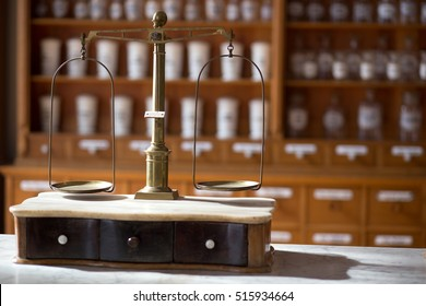 Old pharmacy scale weight. old pharmacy interior with a lot of medicine and old equipment.