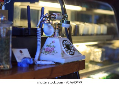Old phone in a coffee shop