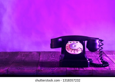 old phone on the wood. Proton Purple color