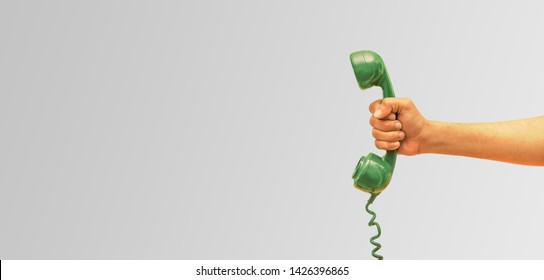 Old phone receiver in hand, businessman holding The old phone receiver, banner background,