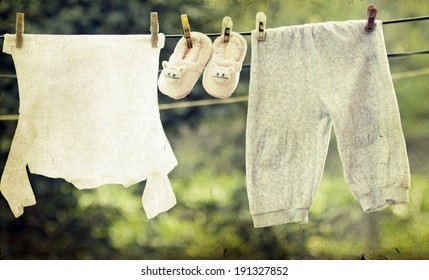 Old photo of baby clothes hanging on the clothesline.