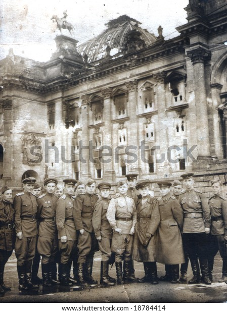 Old photo of Berlin in 1945. Russian soldiers on the background of the Reichstag?. Great Victory in 9 may 1945.