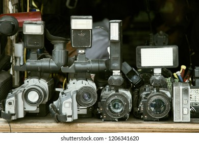 old photo equipment is dusty and not in demand. old video camera