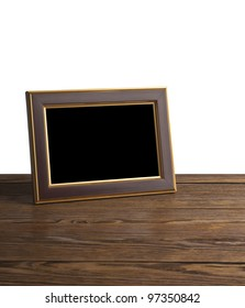 old photo frame on the wooden table