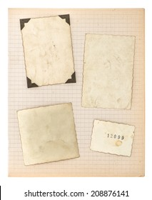 old photo frames and math book page isolated on white background. aged paper