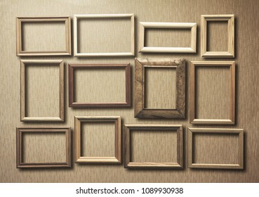 old photo frames on retro wallpaper