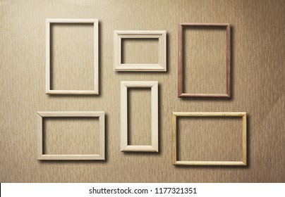 old photo frames on retro wallpaper