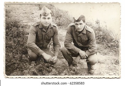 Old photo of two young soldiers