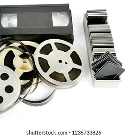 Old photo and video equipment isolated on white background. Retro storage media. Free space for text.
