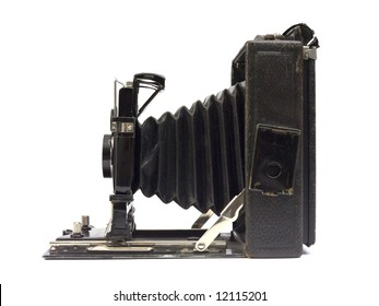 Old photographic camera with lens of bellows. Side view.