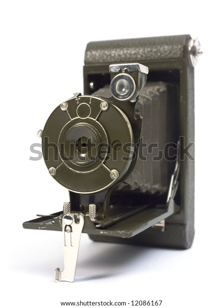 Old photographic camera with lens of bellows.
