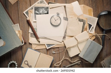 old photos and letters on the wooden table