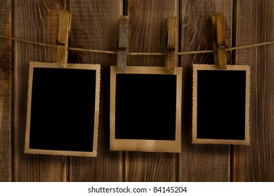 old photos on the background of wooden