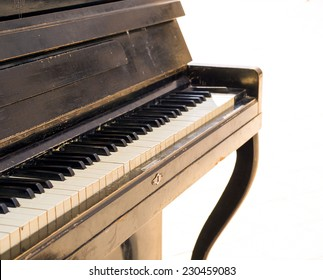 Old piano isolated on white