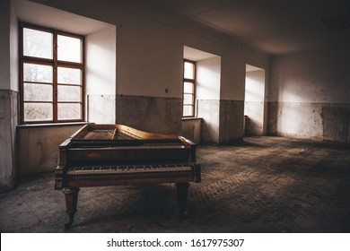 Old piano left in long abandoned chateau