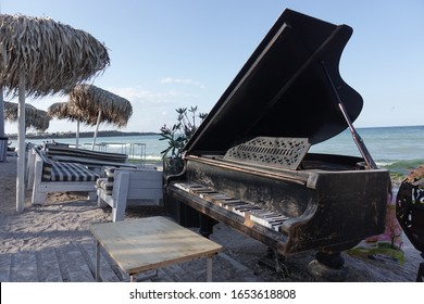 Old piano on the beach of Vama Veche at the Black Sea.