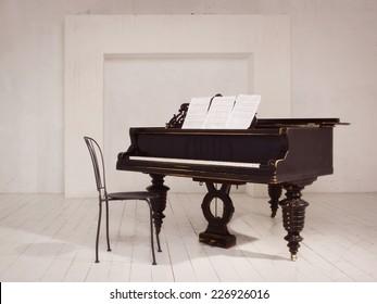 Old piano in a vintage interior