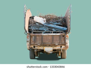 Old pickup truck carring scrap metal for recycling factory, isolated with clipping path.