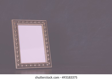Old picture frame against a dirty blackboard background Vintage Retro Filter.
