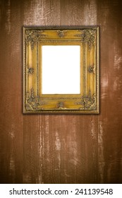 Old picture frame on vintage wood wall.