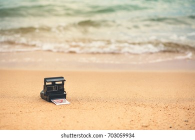 The old picture of memory was left at the beach by the sea. add grain to vintage tones.
