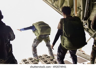 (Old pictures) Rangers parachuted from military airplanes ,  Soldiers parachuted from the plane  ,  isolated airborne soldier  ,  practice parachuting  ,  Paratroopers jumping from an airplane.